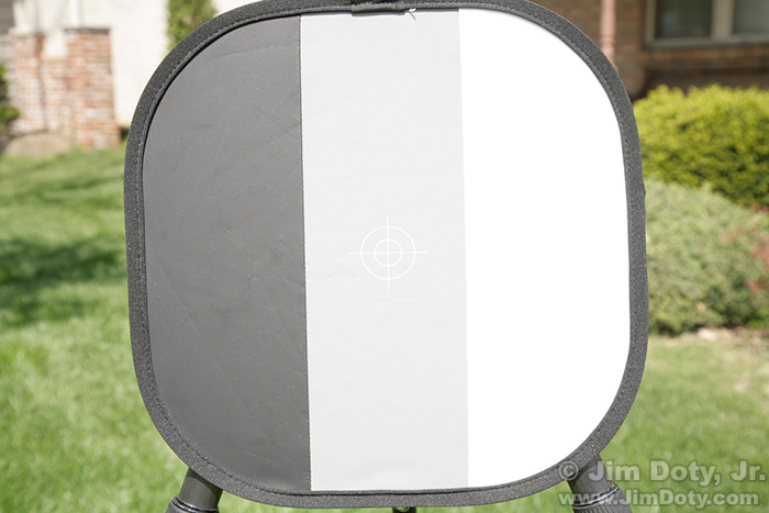Black, gray, and white calibration target, metered for the black panel.