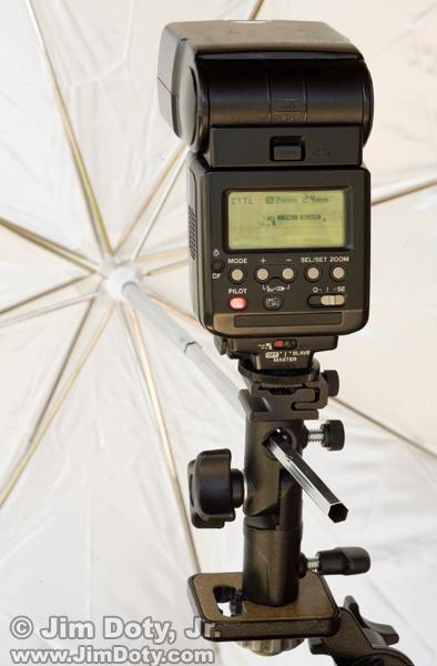 Canon 550EX speedlite with umbrella and umbrella adapter.