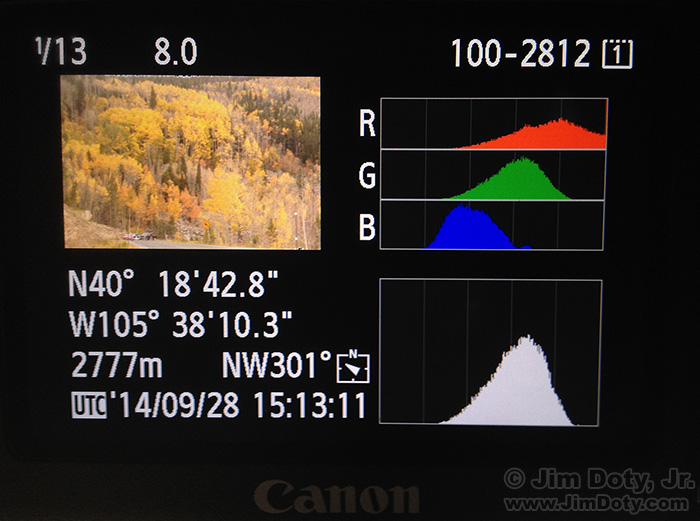 LCD camera display with thumbnail image, histogram, and photo information.