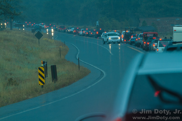 Cars lined up in the rain waiting to exit Rocky Mountain National Park. Sunday evening, September 28, 2014.