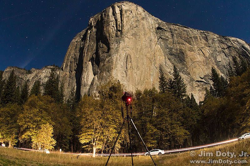 El Capitan in the moonlight. Camera and tripod. El Capitan Meadow, Yosemite National Park.