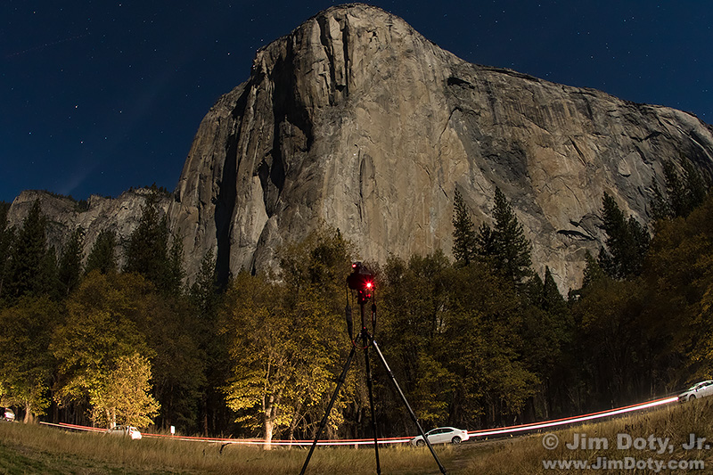 El Capitan in the moonlight, camera and tripod. El Capitan Meadow.