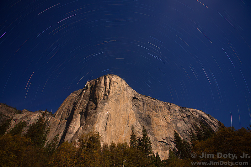 Stars over El Capitan with climbers on the granite cliffs. Yosemite Valley.