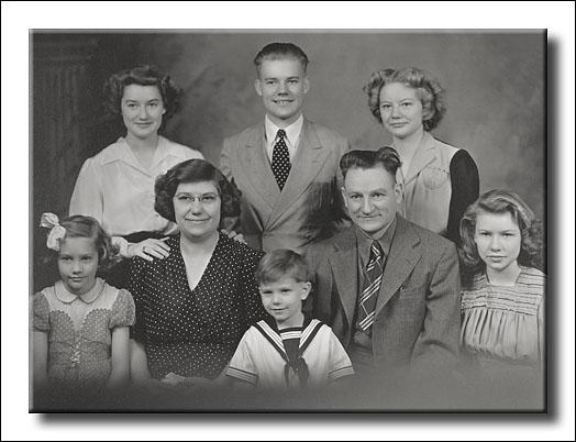 Grandpa, Grandma, and their six children.