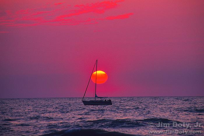 Sunset and Sailboat. Lake Michigan