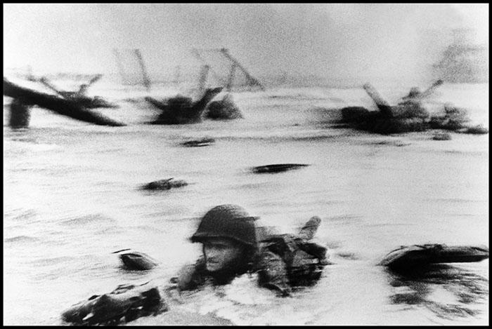 Robert Capa: Normandy. June 6th, 1944. Landing of the American troops on Omaha Beach.